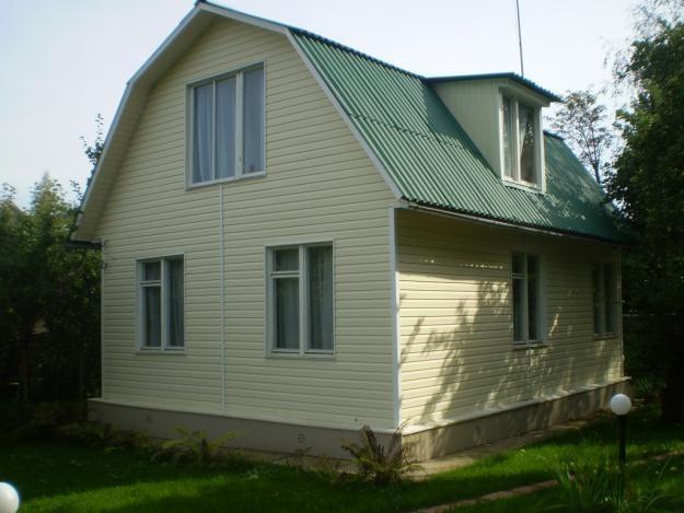 Дом, обшитый сайдингом с утеплителем