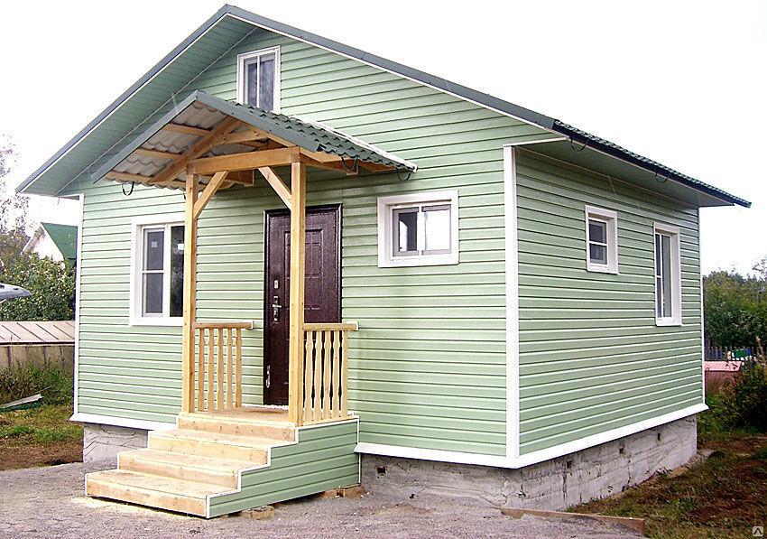 Дом, отделанный металлическим Блок Хаусом