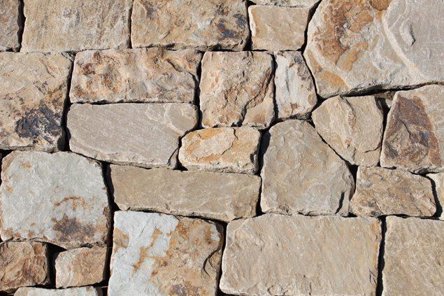 Каменный материал для облицовки фасада