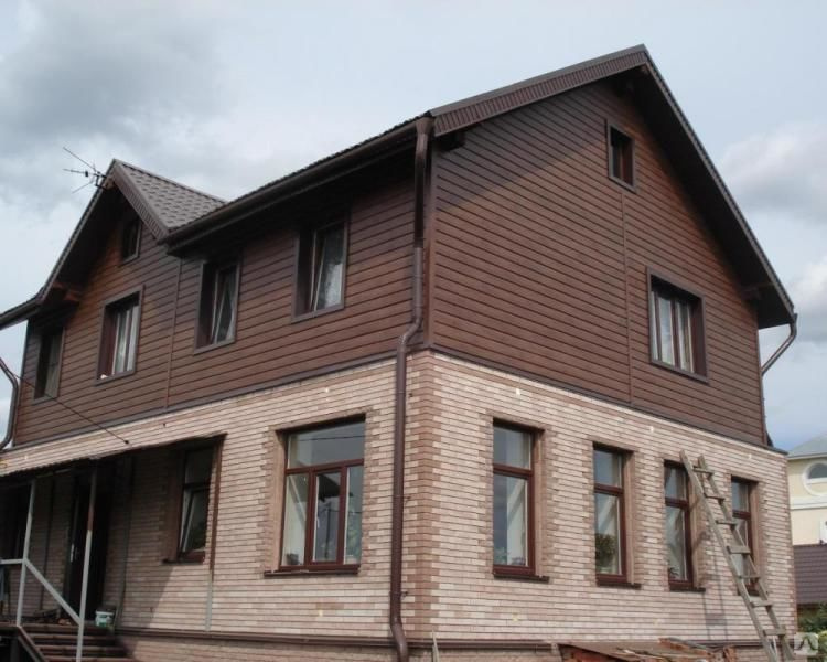 Комбинированная отделка фасада дома