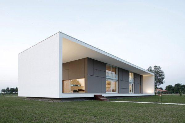 Эффектное сочетание белого и стального цвета в оформлении здания в стиле минимализм