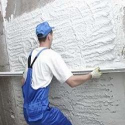 Процесс оштукатуривания фасадов с помощью правила