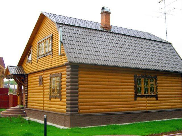 Углы, выделенные темным материалом, делают строение значительно выше