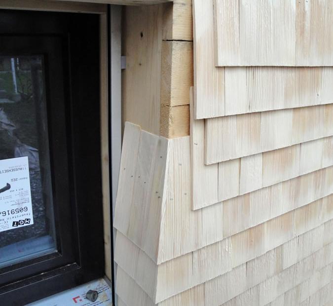 отделка фасада дома деревом